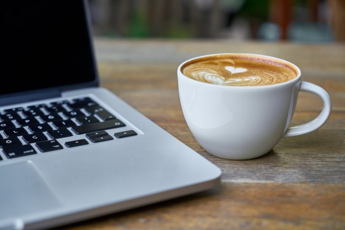 Coffee next to a laptop